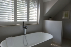 Bathroom Window with White Waterproof Shutters