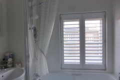 Waterproof Shutters Fitted Over Bath in Bathroom