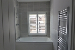 Waterproof Shutter Fitted Over Shower and Bath in Bathroom