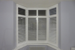 Small Angled Bay Window with White Shutters