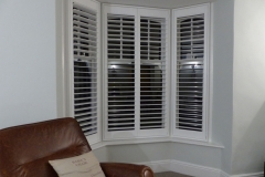 White Window Shutters Fitted to Small Angled Bay
