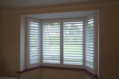 Angled Bay Window with White Shutters