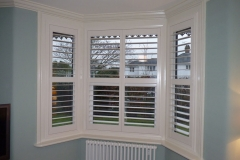 Shutters with Middle Rail Fitted to Angled Bay Window