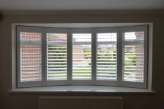 White Window Shutters Fitted to Round Bay in Living Room