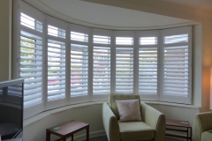 Large Round Bay Window with White Plantation Shutters