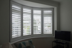 Round Living Room Bay Window with White Shutters