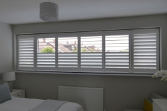 Wide Bedroom Window with Split Tilt Shutters