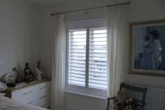Wooden Window Shutters Fitted in Bedroom