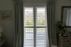 Plantation Shutters with Middle Rail Fitted in Bedroom
