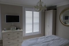 Wooden Plantation Shutters in Bedroom Window