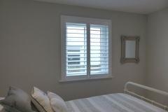 White Wooden Shutters in Modern Bedroom
