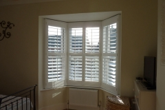 Small Angled Bay Window Fitted with Shutters in the Bedroom