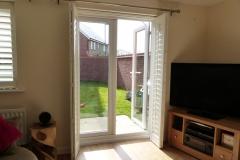 Bi-folding shutters across a door