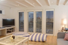 Stylish full height shutters fitted over doors