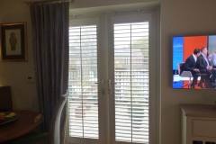 Shutters and no frame mounted on a door