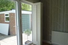 Tracked Bi-Folding Shutters Pushed to Right Hand Side of Patio Doors