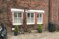 Three Windows With Shutters From Outside The House