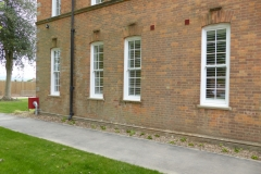 Row of Windows with White Internal Shutters Fitted