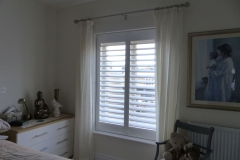 Full Height White Shutters in Bedroom Window