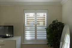 Full Height Shutters with Split Tilt Louvres in Bedroom