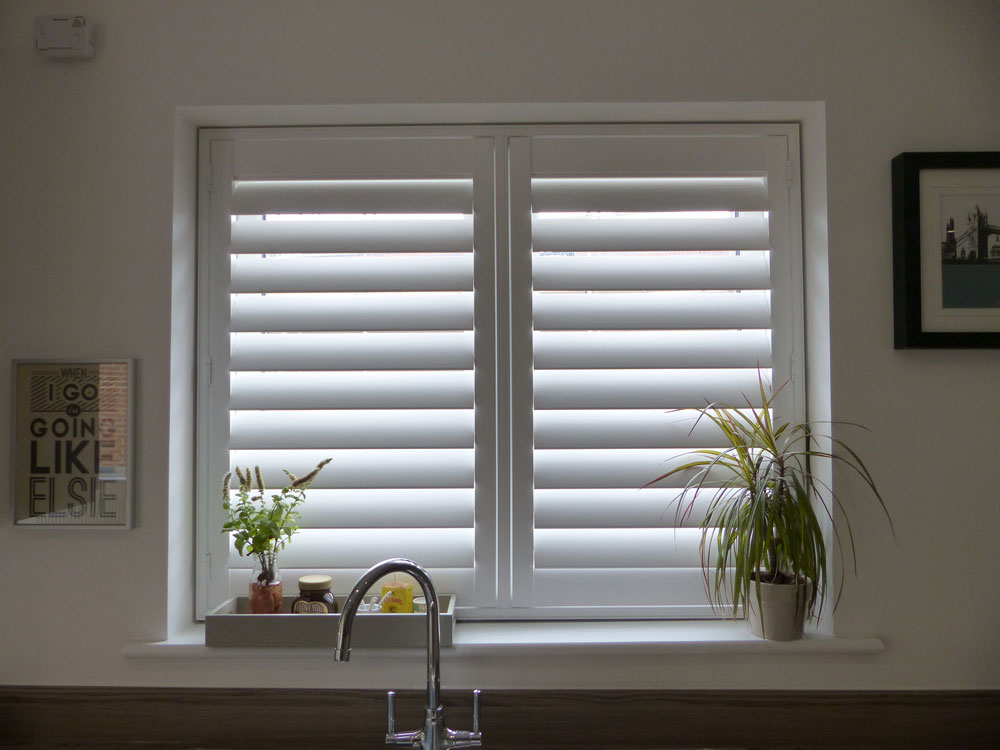 Opennshut expert shutter suppliers for diy trade white tpost shutters fitted to kitchen window above the sink solutioingenieria Choice Image