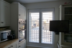 Tall Kitchen Window with White Shutters Fitted