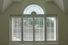 Fan Shaped Window with Louvered Shutters Fitted