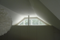 Small Shaped Window with Plantation Shutters Fitted