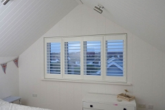 Elite Wood Shutters (Fiji) in a bedroom