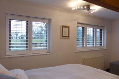 Two Stained Bedroom Windows with White TPost Shutters Fitted