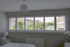 Wide bedroom window with shutters