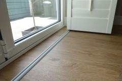 Shutters Mounted on Track on the Floor