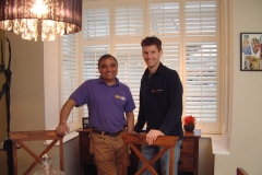 Sam and Billy in front of bay shutters from DIY SOS