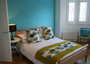 Shutters in a bedroom fitted for The Home Show