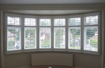 Round bedroom upvc bay and matching plantation shutters