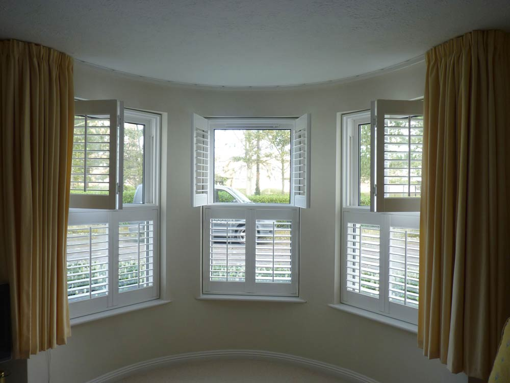 Interior window shutters design options opennshut for Window shutter designs