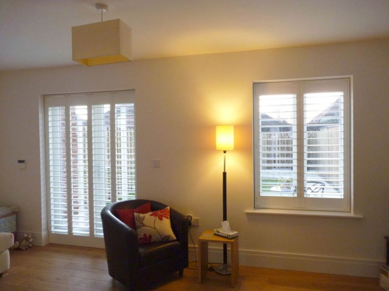 Doors and window with shutters in a lounge