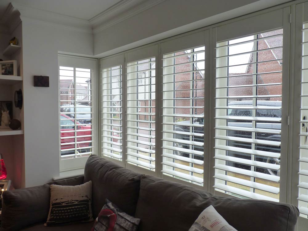 Modern lounge square bay with Plantation shutters