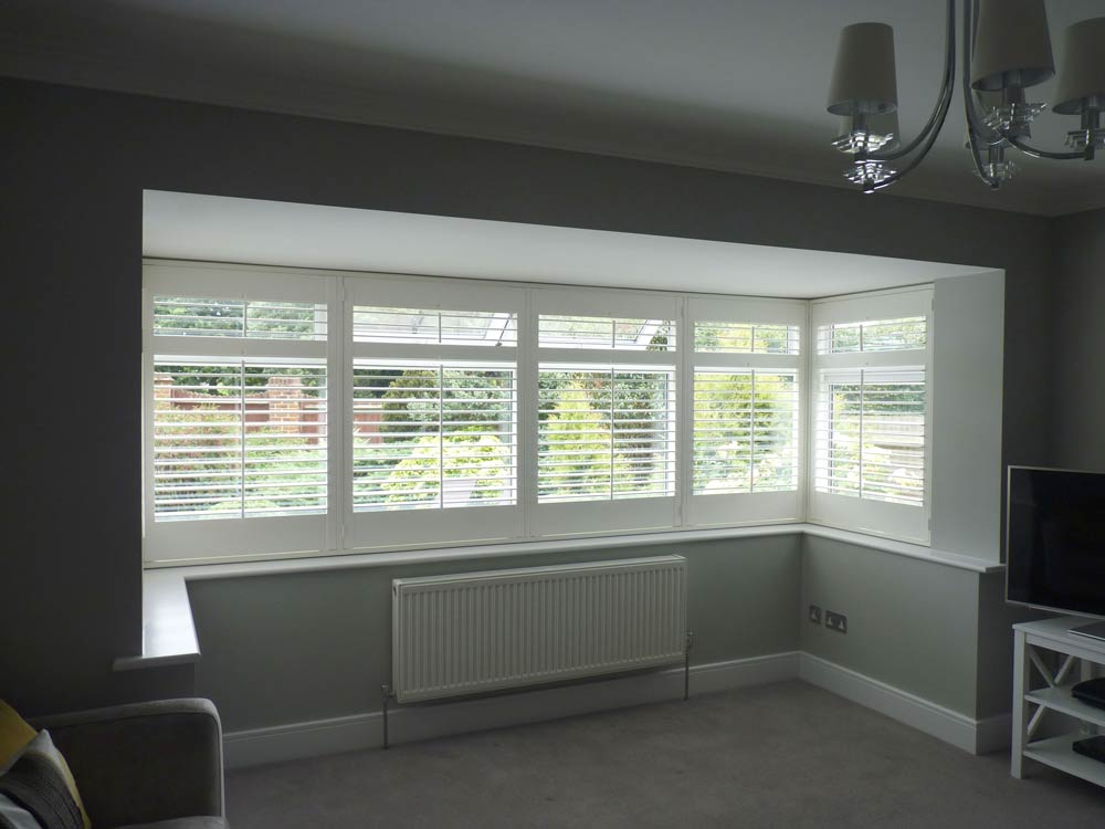 Wide shutters fitted on a wide square bay window