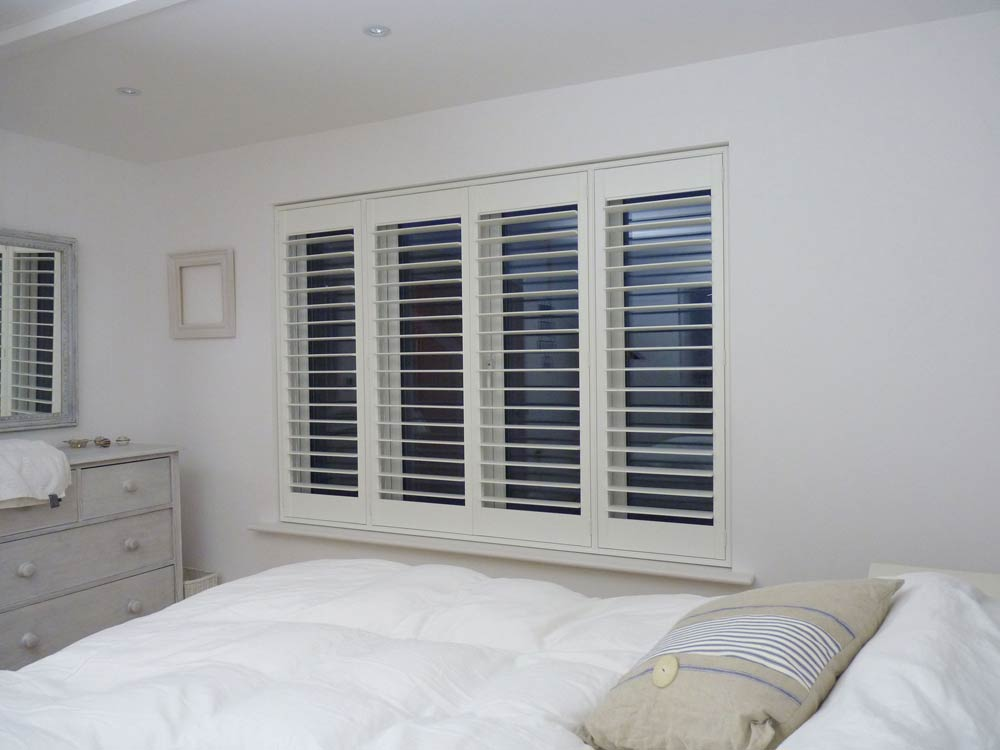 Beach house bedroom shutters