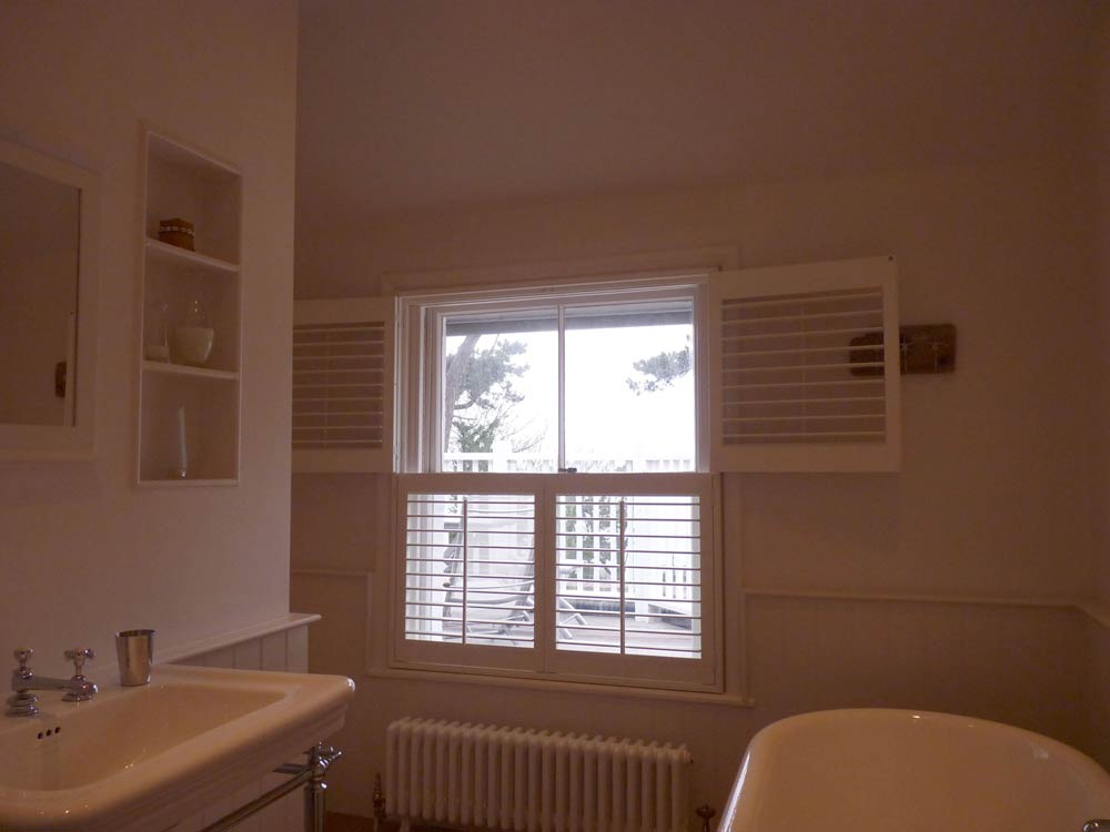 Bathroom split shutter design with panels folded back