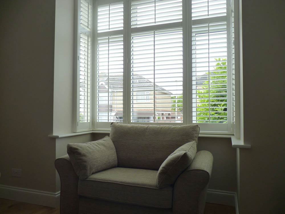 Scraft window shutters fitted to a square bay