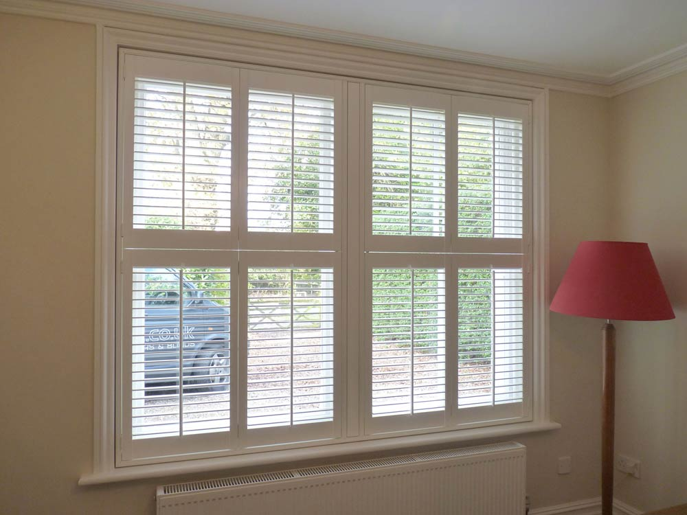 8 tier on tier shutters fitted next to each other on twin sash