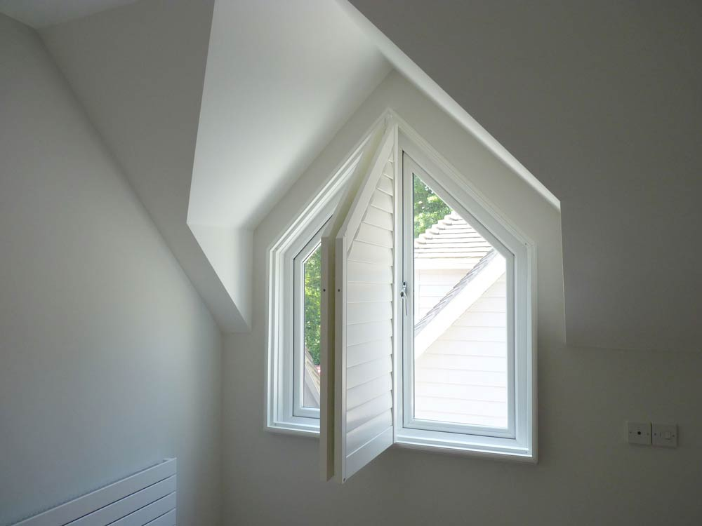 Inward open triangular shutters
