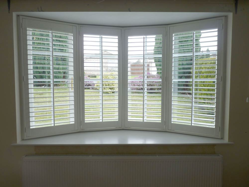 UPVC bay 64mm louvred shutters