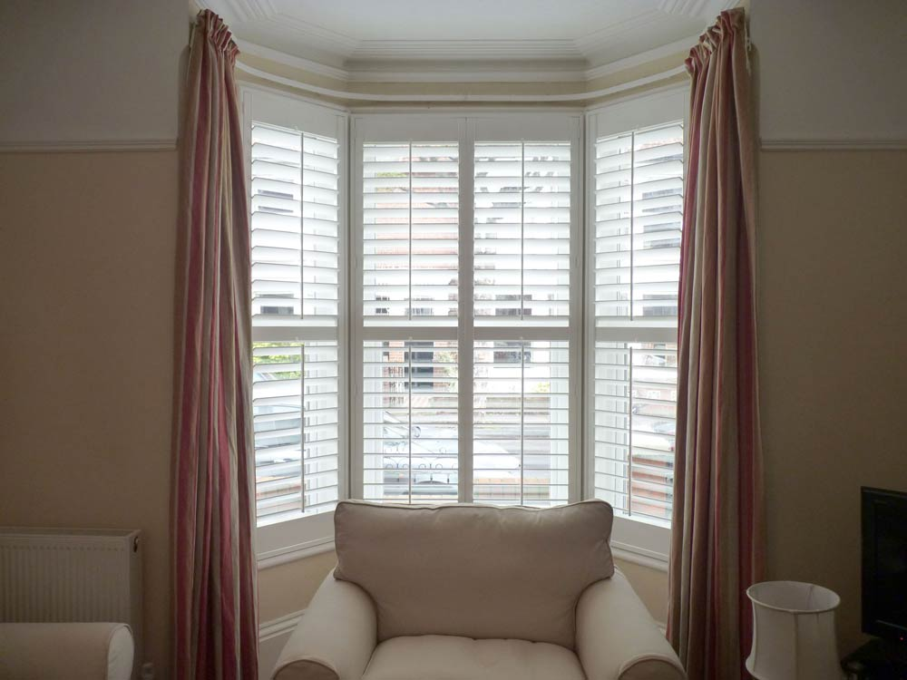 Shutters with curtains