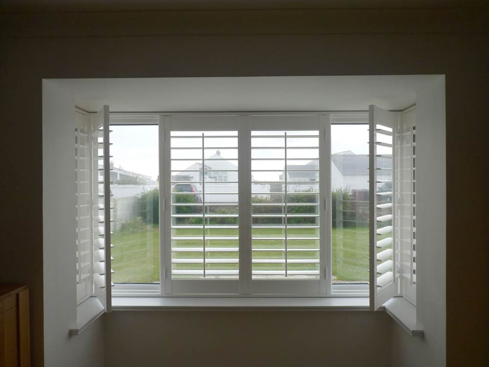 Shutters hinged open on a square bay
