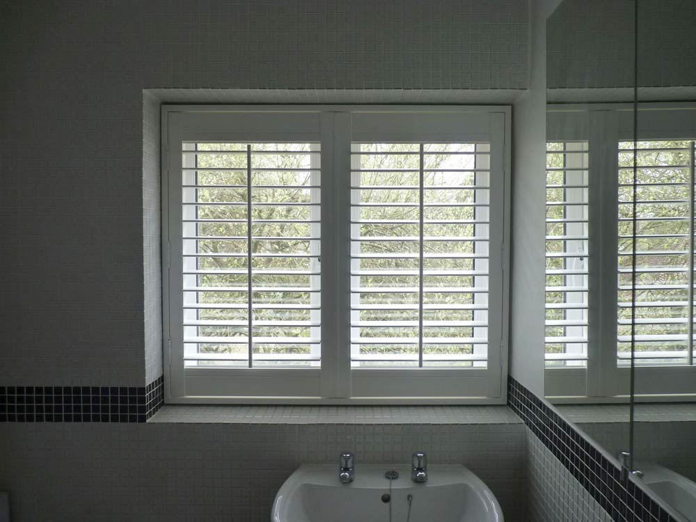 Vinyl shutters in a tiled bathroom