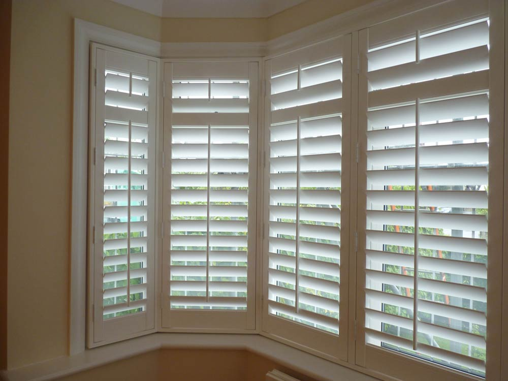 UPVC bay window with full height vinyl shutters