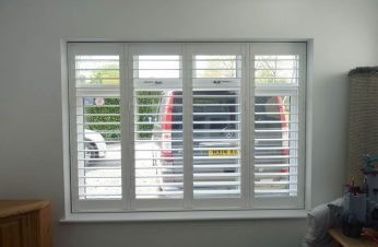 Vinyl shutters with Tposts UPVC window.